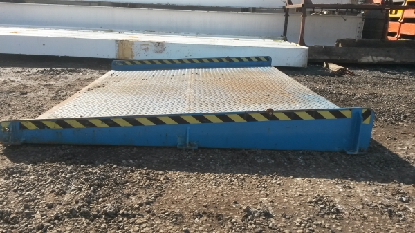 Blue Steel Ramp With Chequer Plate Tread Edged With Yellow & Black Warning Tape